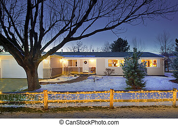 House with Christmas lights on fence - Ranch house with...