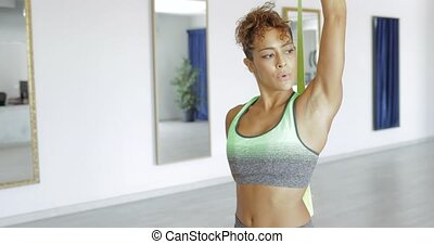 Woman stretching legs with elastic - Attractive black woman...