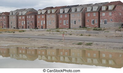 New houses - A line of recently built homes at a new housing...