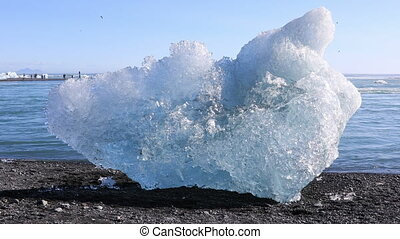 Chunk of ice from the Jokulsarlon glacial lagoon washed up...
