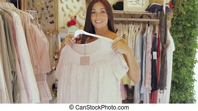 Cheerful woman posing while shopping - Young excited...