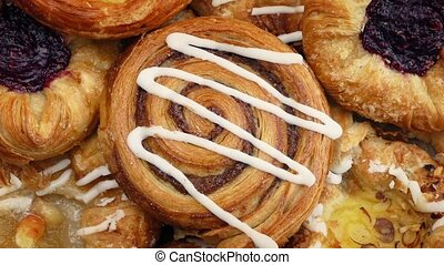 Tasty Pastries Rotating Closeup - Tasty mixed pastries on...