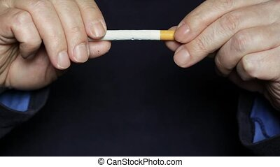 Stop smoking - Hands break a cigarette
