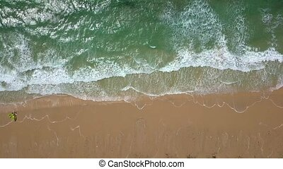 Tropical shoreline in sunlight - Top view of crystal clear...