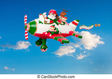 Flying Santa Claus with Elves in Airplane - Santa Claus...