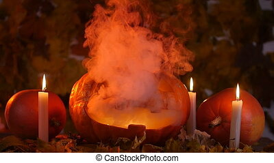 Scary carved pumpkin on Halloween in hot fire and smoke....