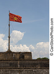 Vietnam Flag - Vietnam flag standing on flag pole above...