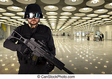 Defense against terrorism, a soldier at an airport - Defense...