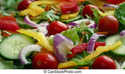 Mixed Salad With Peppers And Onions - Fresh salad turning...