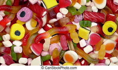 Pile Of Mixed Candies Rotating - Mixed pile of candy turning...