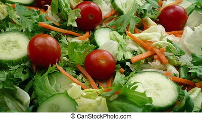 Fresh Mixed Salad - Fresh salad turning slowly with lettuce,...