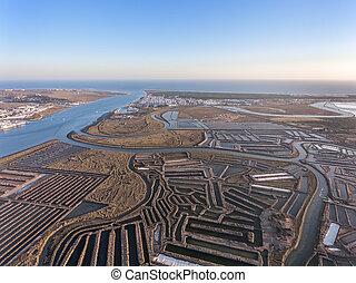 Aerial. Textured fields of swampy salt lakes. Vila Real...