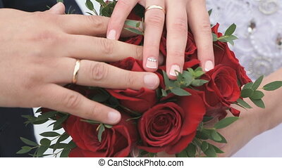 Close-up of hands of newlyweds - Close-up of hands of bride...