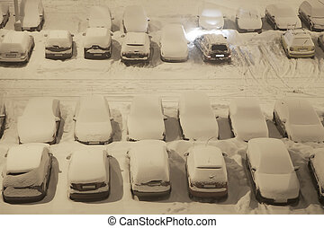 Car park under snow in the night