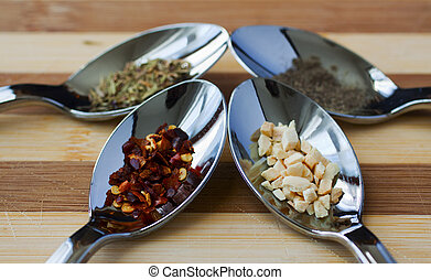 Spices - Four different spices chilli, pepper, thyme, garlic...
