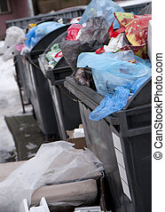 Overfull cans - Overfull garbage cans in the streets