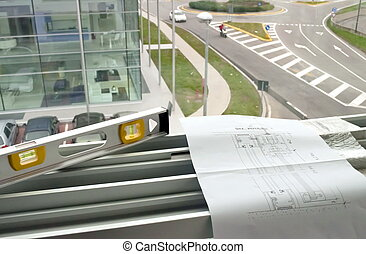 Engineering plans over a steel structure with tools