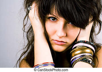 young brunette lady with bracelets - closeup portrait of...
