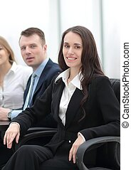 business woman and business team - businesswoman sitting...