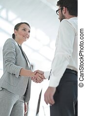 close-up. handshake business partners - business woman...