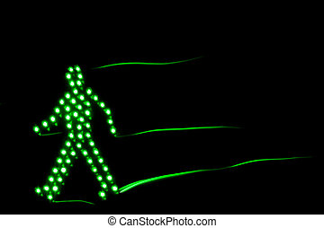Pedestrian traffic light green, isolated on a black...