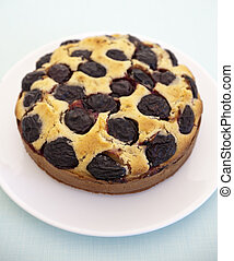 contry plum cake on a wooden surface