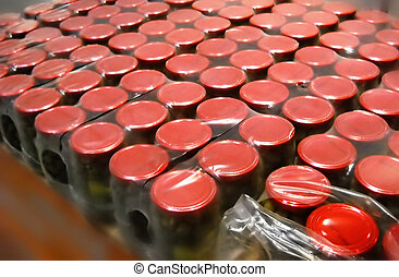 Food store - lot of glass jars red covers in store