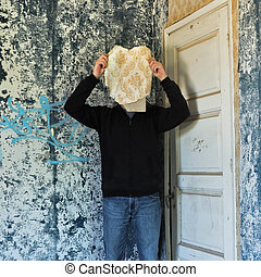 memory mask - Figure obscured by torn wallpaper shred in...