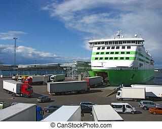 Trucks boarding ferry - Cargo trucks boarding large ferry in...