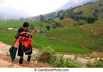 Sapa hill tribe woman and baby - Traditionally dressed Sapa...