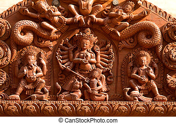 Hindu Gods carved on wood - carved sculptures of differents...