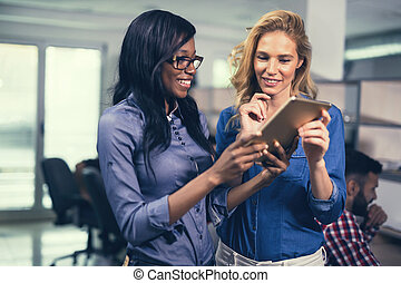 Business women working at IT company in modern office