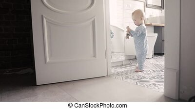 Child make his first steps intdoor - A little 1 year old...