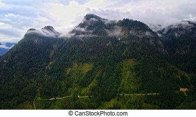 Drone aerial view - flying over Alps, Austria, cloudy...