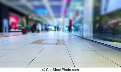 Walking in the shopping mall - Low angle view of the walking...