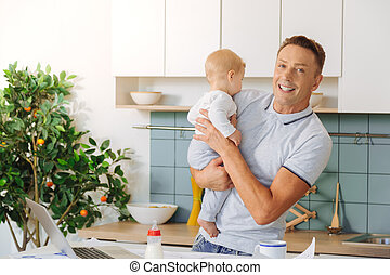 Positive delighted man looking at you - Loving father....