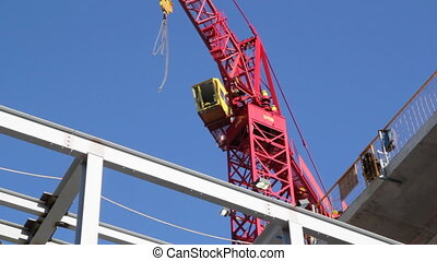 Red tower crane. Closeup. - Closeup of red tower crane at...