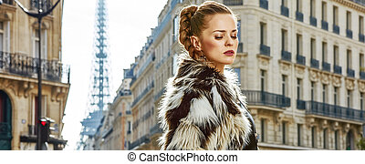 relaxed trendy woman in fur coat in Paris, France - Boiling...