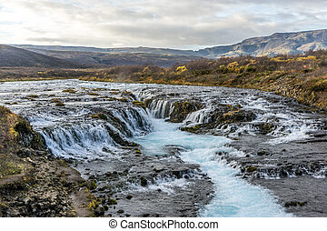 Bruarfoss Waterfall Iceland - The beautiful Icelandic...