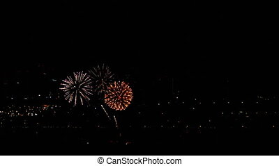 Fireworks flashing in the evening sky.