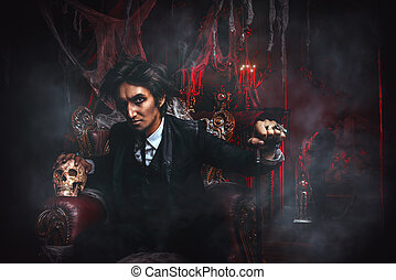 vampire man in a castle - Halloween. Frightening gloomy man...