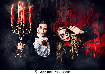 scare in the old castle - Halloween. Two children in...