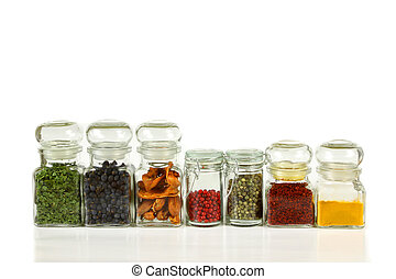 Kitchen jars - lass jars with colorful herbs and spices...