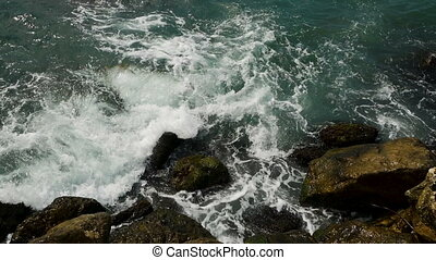 waves with foam of the sea in Montenegro beating on the...