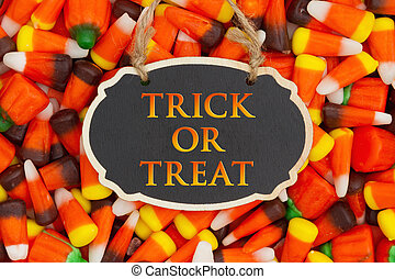 Trick or Treat Greeting with candy corn on a hanging retro...