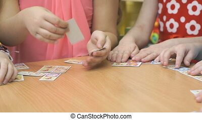 Little children playing in developing game - Close-up of...