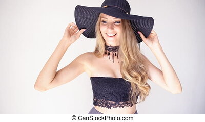 beautiful girl in a hat with a brim fashion poses 1