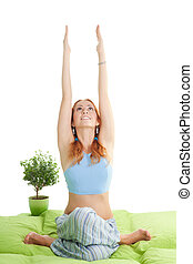 woman with red hair do yoga exercises - Young happy woman...