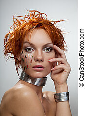 Studio fashion portrait of young futuristic woman with chips...
