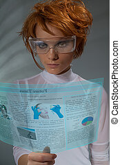 Future times - Future newspaper on transparent screen -...